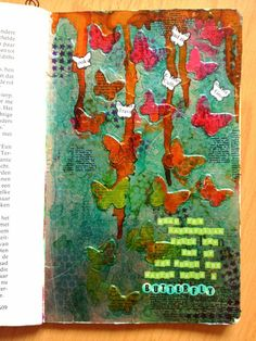 For this page I punched a bunch of butterflies from cardstock and glued them on my page. Then I covered the whole page with an adhesive sheet from Scrapbook Adhesives by 3L and carefully layered the tin foil on top. I rubbed the tin foil gently with a cloth to make the butterflies under neath pop up.