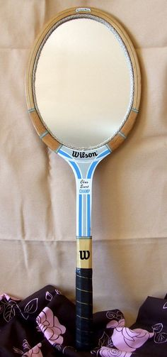Tennis racket mirror.     Gloucestershire Resource Centre  http://www.grcltd.org/scrapstore/
