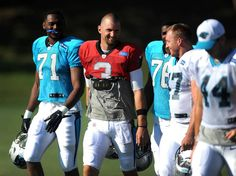 Carolina Panthers quarterback Derek Anderson, center, jokes with his teammates as they walk to practice on Sunday, August 2015 at Wofford College in Spartanburg, SC. Derek Anderson, Carolina Panthers, Super Bowl, Nfl, Sunday, Jokes, College, Chistes