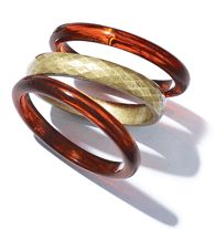 Fade to Dusk Bangle Set  Set of 3 bangles: 2 faux tortoise shell bangles and one faux metal hammered bangle.