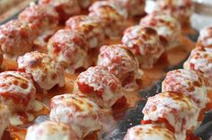 Chicken Parmesan Meatballs - All the flavors of classic Chicken Parmesan are rolled into these bite size meatballs. If you have never considered making homemade meatballs before, this is a very simple recipe and a great one to make for your first time!