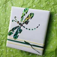 Dragonfly Gift Wrap - cut dragonfly out of a foil gift bag using this pattern https://www.pinterest.com/pin/468726273690371065/
