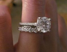 love the thin engagement ring band with the big wedding band