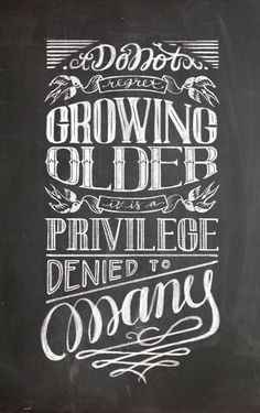 Do not regret Growing Older. It is a privilege denied to many. Chalkboard sign poster. Hand lettering by Helena Ecija