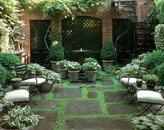 Sawyer Berson Townhouse Garden with painted lattice screens  On Perry Street - NYC - Courtyard garden