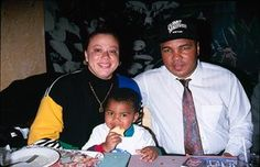 Ali with his fourth wife Lonnie and adopted son, Asaad Amin, in 1990.