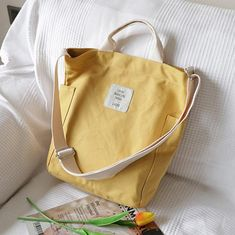 Women Design Casual Patchwork Large yellow Canvas Shoulder Bag Materials used: CanvasMeasurement:One size Length 26cmWidth 13cmHeight 34cmWe ship worldwide.Tracking numbers provided for all orders. Canvas Crossbody Bag, Canvas Messenger Bag, Canvas Tote Bags, Diy Sac, Bag Women, Tote Bags Handmade, Pink Tote Bags, Canvas Handbags, Canvas Shoulder Bag