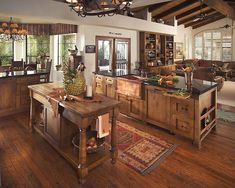 If you're in need of a little home renovation inspiration for your kitchen, we're one step ahead of you. Check out these kitchens below that we can't get over. They have a rustic feel and look that can be incorporated into any modern western home. (Pictured Above) Open Rustic Kitchen Photo courtesy of Architectural Digest …