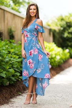 """Cold Shoulder Ruffled Floral Maxi Dress, Blue""Of course this wrap dress is flattering! That's just what wrap dresses do! They flatter! #newarrival #shopthemint"
