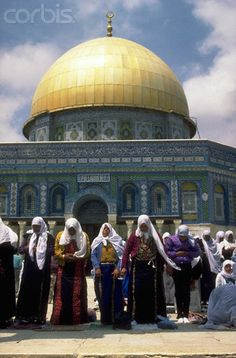 Observant Muslim women in tradition modest dress during the holy month of Ramadan, on the Dome of the Rock in Jerusalem.   Date Photographed: 	ca. 1987