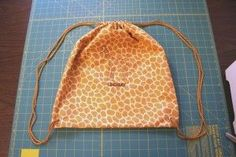 """drawstring backpack tutorial.  This was so easy to make, I put one in each of my boxes this year to help carry their """"goodie"""" home. :)"""