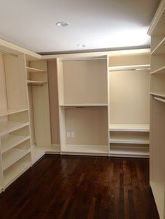 Walk In Closet In Cream With Shoe Shelves And Crown Molding ClosetsbyDesign  Boston Carolyn Scarinci