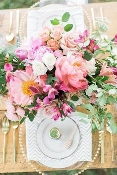 Pretty pink centerpiece with Coral Peonies, Roses, and Sweet Peas. #wedding #flowers