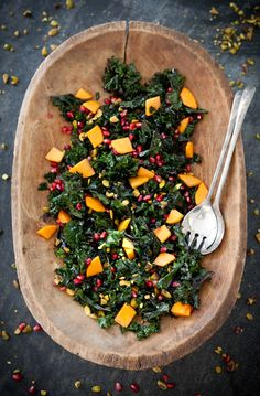 kale with pomegranate, persimmon and pistachio