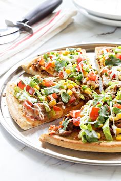 Taco Pizza Pie will make any kid and adult totally happy. A great weeknight dinner when you need something fast and satisfying!