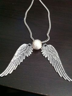 Harry potter snitch necklace... and although it's SUPPOSED to be gold, let's agree that silver is better