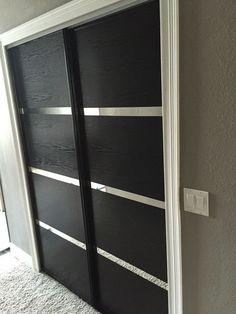 Updated some dated mirror closet doors with wood grain adhesive vinyl.