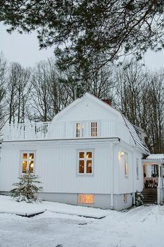 Exterior of a snowy white house