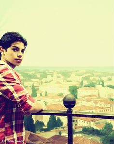 (Open rp) I stand looking over a balcony when I hear a female voice calling my name.../Jake/