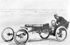 Olds at the wheel of the Olds Pirate on Ormand Beach c.1896.
