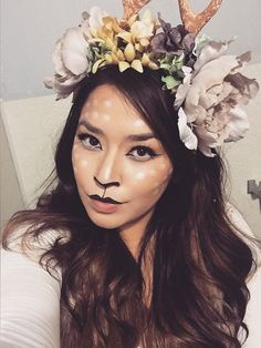 Deer make up and flower crown with antlers for Halloween.