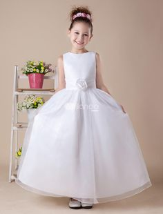 White Tea Length A-line Satin First Communion Dress. Your daughters First Communion is a memorable event in her lifetime so her dress should be memorable, too. This one features a rounded neckline and wide straps on the bodice, which is embellished in the center with a .. . See More First Communion Dresses at http://www.ourgreatshop.com/First-Communion-Dresses-C911.aspx
