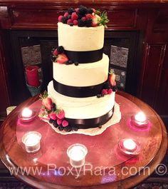 www.RoxyRara.com. Three tier rustic wedding cake.  Top tier - carrot cake with cream cheese frosting.   Middle tier - lemon drizzle with lemon curd buttercream.   Bottom tier - vanilla cake with vanilla butter cream and raspberry conserve.   All topped with fresh fruit.   To book in your wedding cake tasting and consultation email: cake@roxyrara.com.