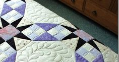 This is Gail's Tennessee Waltz  quilt and I love the soft purple and cream fabrics she used to piece it.  It is a very traditional quilt...