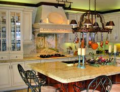images of kitchen island made from cabinets | Tuscan kitchen with custom made kitchen cabinets, venetain plaster ...