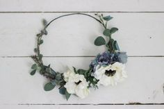 Beautiful anemones, dusty blue florals, lavenders and greenery. Medium/Large statement crown perfect for a styled shoot, maternity shoot and events! Adult sizes only due to sizing of florals.   **Production time is 5-7 days because each crown is carefully handcrafted, that does not include shipping time. Note: the crowns WILL be more of a statement crown on children. **Every crown is made to order and may vary slightly from the picture.  **If youd like a sure fit, please choose your head…