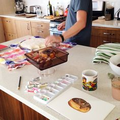 Behind the scenes of a Walters morning: I'm on sprinkles duty painting my watercolor donuts while Cameron does homemade English muffins. (I am very excited by the muffins.) This donut was one of the 2014 Donuts of the Bay Area calendar models.