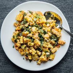 A super easy grilled corn salad with poblano chile for an extra kick. You don't need to presoak or preshuck the corn before grilling—trust us!