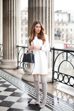 Lydia Lise Millen looks effortlessly sophisticated in this little white dress, paired with grey thigh high boots and accessorised with a minature box bag from Louis Vuitton.Dress: Club Monaco, Boots: Public Desire, Bag: Louis Vuitton, Watch: Chanel.