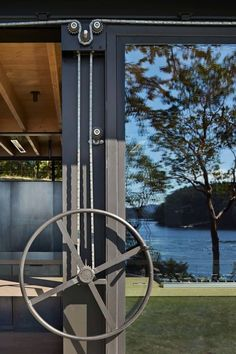 An intimately designed retreat by Olson Kundig Architects lies nestled on a dense, wooded shoreline site on the San Juan Islands, Washington. Kinetic Architecture, Architecture Details, Modern Exterior, Interior And Exterior, Bbq Shed, Orcas Island, Cedar Siding, San Juan Islands, Stairway To Heaven