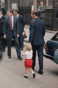 Prince Charles arrives at St. Mary's Hospital in Paddington, London with his son Prince William on Sept. 16, 1984. They were at the hospital to take Princess Diana and new baby, Harry, home.