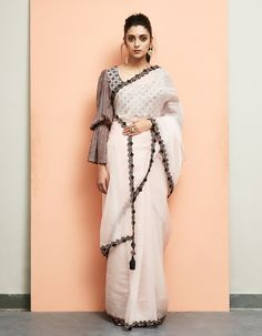 Pick a saree of black & white to flaunt any occasion, it can be of stripes, or with a unique pattern. The styling speaks louder about the complete look. Chiffon Saree, Saree Dress, Chiffon Blouses, Designer Salwar Kameez, Saree Blouse Patterns, Saree Blouse Designs, Indian Dresses, Indian Outfits, Saris Indios