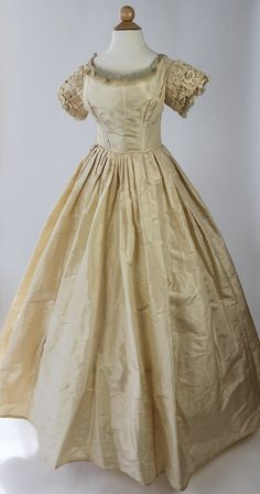 Ivory Silk Taffeta Wedding Gown with Rosebud Trimmed Neckline from 1857 | eBay One piece silk taffeta wedding gown with back lacing bodice and self fabric rosebud and silk tulle trim at neckline and sleeve edges. Measurements: Bust:  26 inches (66 cm) Waist:  19 inches (49 cm) Skirt Length:  50-56 inches (127-142 cm)