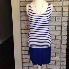 Adorable Stripe Dress Gently loved dress. Has a faux leather bottom. Has a lining underneath the dress. Measures 32 1/2 inches long. Anthropologie Dresses
