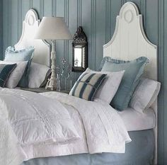 ~tie in wall color with bedskirt and pillow sham.  Dark grey (looks like) beside table.  Dark something or other on wall could tie in your hardware in bathroom, rbt.