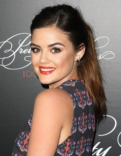 Lucy Hale. Lucy looked great with her lips a bright red/orange color. It's a perfect summer color and lightens up her already flawless complexion.#prom #eyes #red #lips