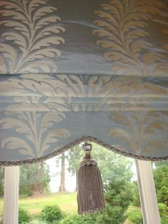 Roman blind with shaped, trimmed hem