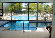 "indoor and outdoor pool that are separated only by a ""garage door"" perfect for all seasons"