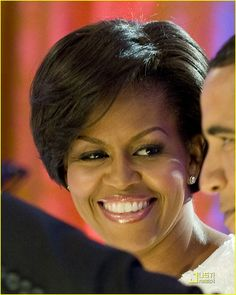Methinks that the First Lady is singing 'My Guy' to herself.  Don't you think?!