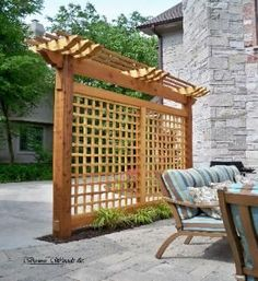 A combination pergola/trellis provides privacy for this outdoor dining area.  - Bower Woods llc. Custom Garden Structures, Trellis