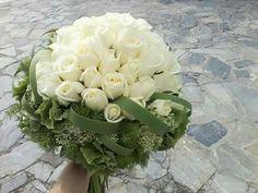 Wedding bouquet, roses trachilium, huydrangea and typha grass