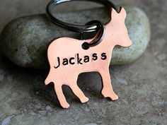 """Jackass Donkey key chain in copper. Fun little cheeky gift for that someone...""""special"""". Let them know what they mean to you with this cute little Donkey key chain stamped with the word """"Jackass"""" Materials/Sizes/Etc 1 1/4"""" 18G Donkey A set of sturdy stainless steel split rings ."""