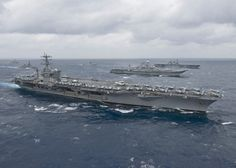 USS Nimitz leads a formation of ships in the Bay of Bengal as part of Exercise Malabar 2017.