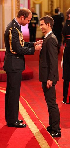Prince William presents tennis player Andy Murray with an OBE at Buckingham Palace 17 Oct 2013