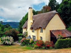 So, if I can't live in a hobbit house, I could be happy with this story book cottage.