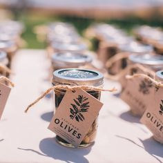 Olive jar wedding favors that double as escort cards | Dennis Kwan Weddings | Brides.com